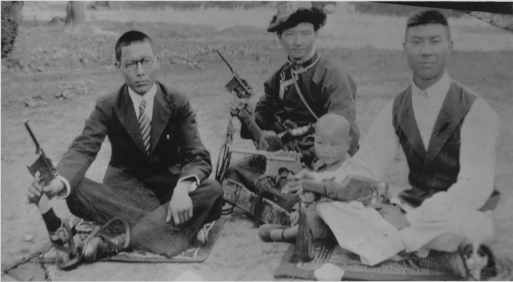 My father in the middle in Tibetan garb, and his cronies holding German Lugars. Older brother, John beside him